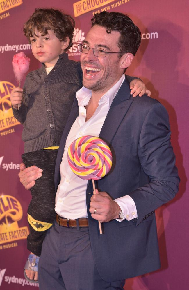 Joe Hildebrand with his son on the opening night of Charlie and the Chocolate Factory. Picture: Flavio Brancaleone