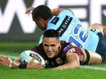 Valentine Holmes of the Maroons scores a try during Game 3 of the 2018 State of Origin series between the NSW Blues and the Queensland Maroons at Suncorp Stadium in Brisbane, Wednesday, July 11, 2018. (AAP Image/Jono Searle)