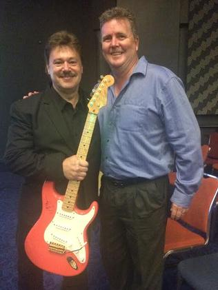 Greg Doolan and Shane Veen at Twin Towns with a guitar formerly owned and used by Doolan's childhood idol — Hank Marvin.