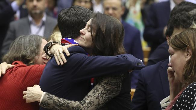 MEP's embrace after a vote on the UK's withdrawal from the EU. Picture: Yves Herman/AP