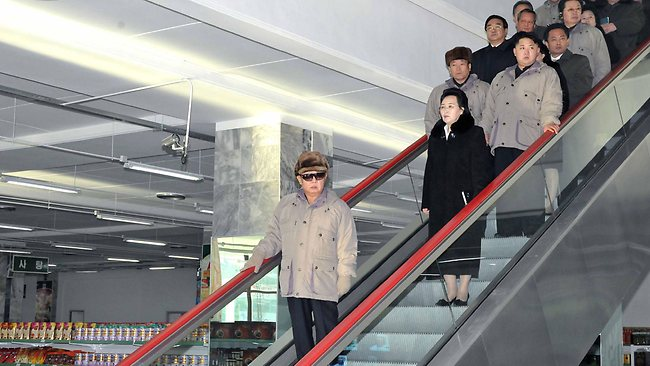 """This undated picture, released from North Korea's official Korean Central News Agency on December 17, 2011 shows North Korean lreader Kim Jong Il (C), accompanied by his son Kim Jong Un (R), inspecting the Kwangbok Area Supermarket just before opening in Pyongyang. AFP PHOTO / KCNA via KNS ---EDITORS NOTE---HANDOUT RESTRICTED TO EDITORIAL USE - MANDATORY CREDIT """"AFP PHOTO / KCNA VIA KNS"""" - NO MARKETING NO ADVERTISING CAMPAIGNS - DISTRIBUTED AS A SERVICE TO CLIENTS"""