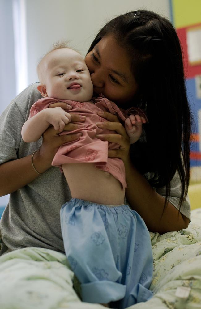 Rejected because of disability? ... Pattaramon Chanbua plays with Gammy. Picture: AFP