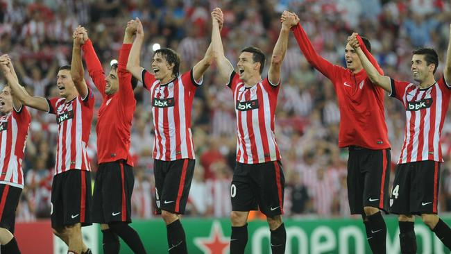 Athletic Bilbao's players celebrate after winning the UEFA Champions League play-off second leg.