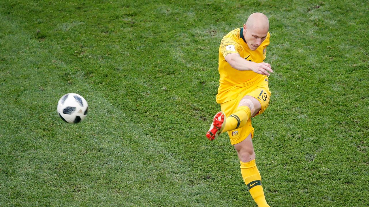 Australia's midfielder Aaron Mooy kicks the ball