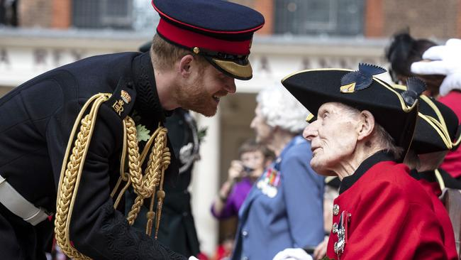 Prince Harry shakes hands with a Chelsea Pensioner. Picture: Heathcliff O'Malley — WPA Pool/Getty Images