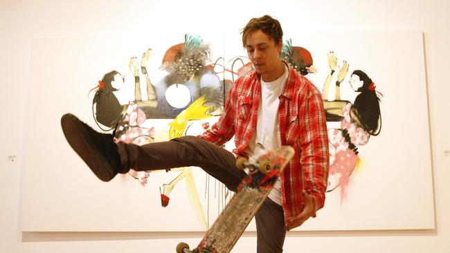 Anthony Lister with his skateboard at an exhibition in Armadale.