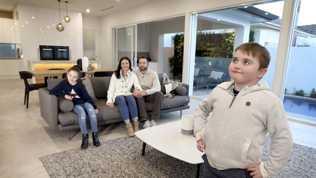 Tyler O'Connor, 7, and his family – mum Amanda, dad Adam, and sister Georgia, 9, inside the Somerton Park home people can win in Muscular Dystrophy SA's My Dream Lottery. Pic: Dean Martin
