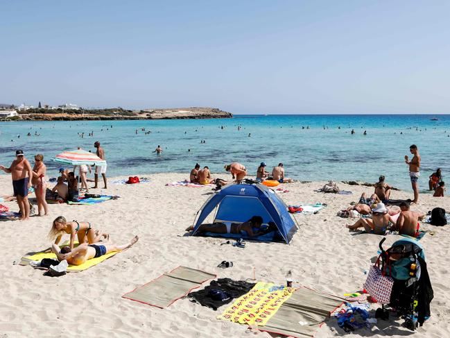 Tourists sunbathing on Nissi Beach, on the western outskirts of the Cypriot resort town of Ayia Napa. Picture: Amir Makar