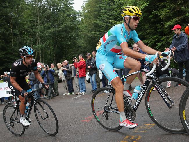 Richie Porte follows the wheel of Vincenzo Nibali in the climb of the Col des Chevreres.