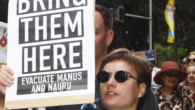 A woman last weekend calls for refugees at Manus Island to be brought to Australia.