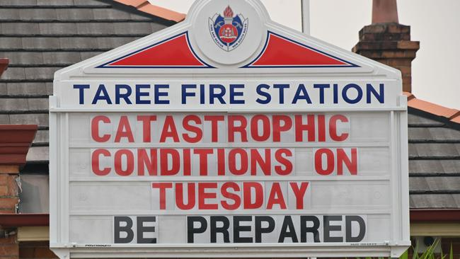 A sign on a fire station in Taree, 350km north of Sydney, warns of 'catastrophic' fire conditions for today. Picture: Peter Parks / AFP