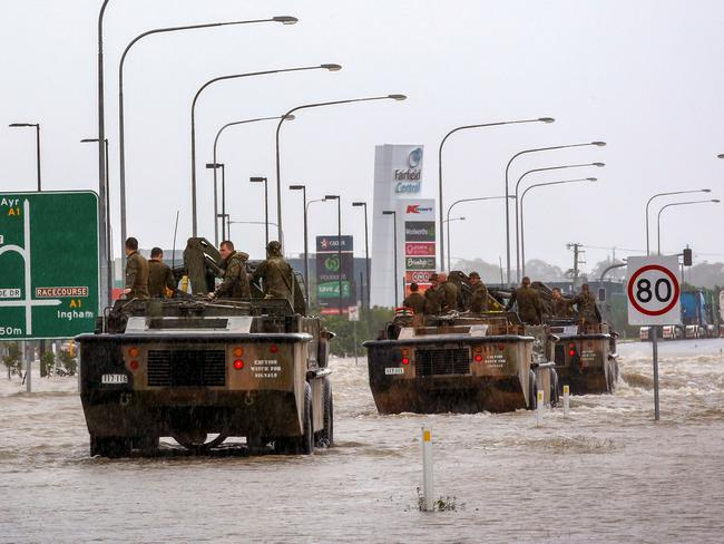 Army vehicles enter Townsville to help evacuate people. Picture: STR/AFP