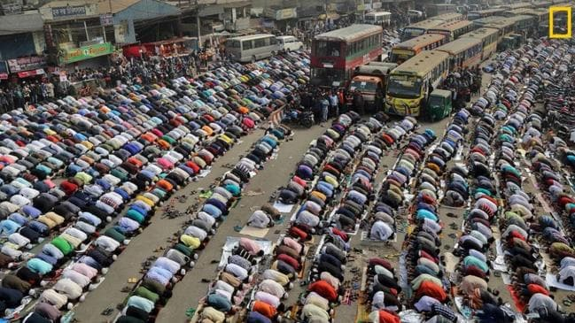People pray on the street in Dhaka, Bangladesh during Ijtema. Bishwa Ijtema is one of the major Islamic religious gatherings observed annually in Dhaka, and millions of Muslims visit during this time. Picture: Sandipani Chattopadhyah /National Geographic Travel Photo Contest
