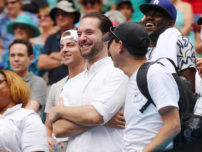 Serena Williams' fiance Alexis Ohanian smiles during her post-match interview.