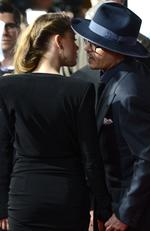 """Actor Johnny Depp and actress Amber Heard arrive at the premiere of """"3 Days to Kill"""" at ArcLight Cinemas on February 12, 2014. Picture: Jason Merritt/Getty Images"""