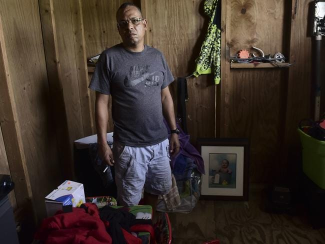 San Juan resident Gabriel Figueroa told AP his landlord moved to the US mainland and hasn't bothered to replace his roof. He is saving up to do it himself Picture: AP/Carlos Giusti