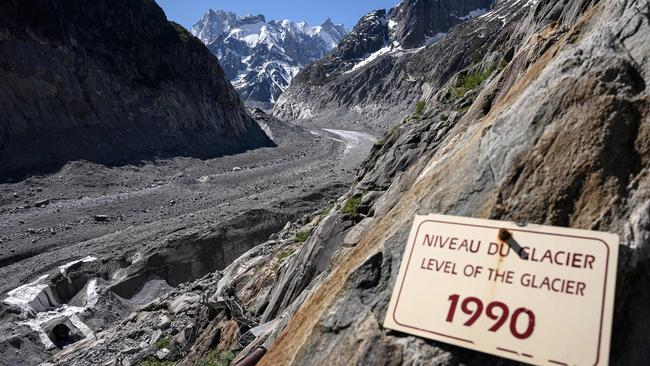 The board indicating the level of the Mer de Glace glacier in 1990 pictured in June, 2019. Photo: Marco Bertorello/AFP