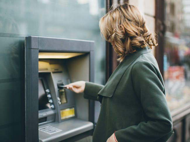 40 per cent of overseas Aussies surveyed admitted being slugged with a pricey ATM fee in the past year.