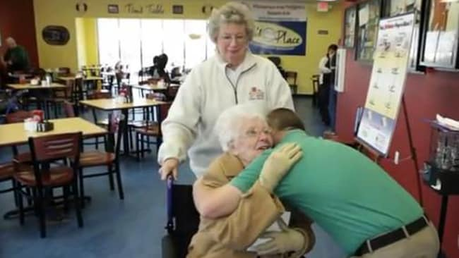 Tim has given out more than 30,000 hugs. It's on the menu. Picture: AOL