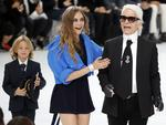 Designer Karl Lagerfeld, godson Hudson Kroenig and Cara Delevingne appear at the end of Chanel's Spring/Summer 2016 women's ready-to-wear show during Paris Fashion Week. Picture: Reuters