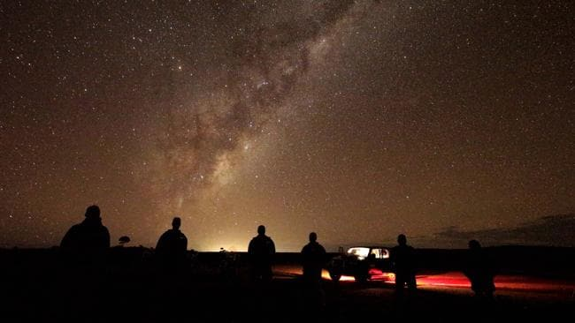 Tourists gaze at the milky-way near Broken Hill. Picture: AP