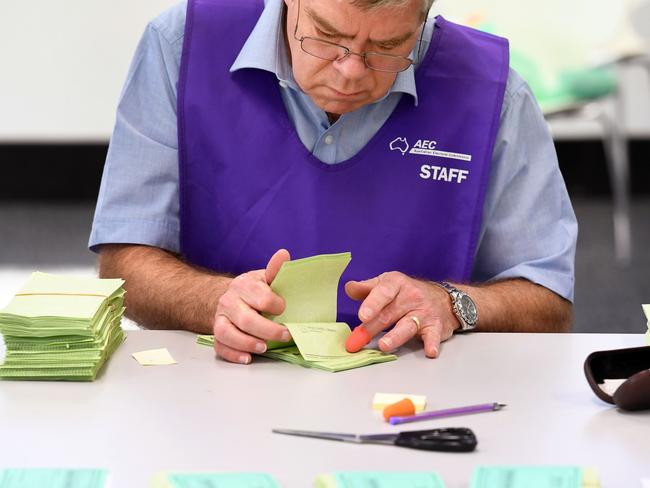 A temporary AEC worker counts votes in Sydney on July 5. Picture: William West.