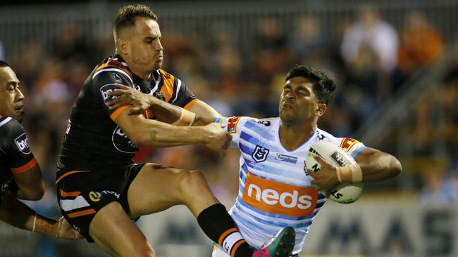 Tyrone Peachey breaks through a tackle during the Round 7 NRL match between the Wests Tigers and the Gold Coast Titans