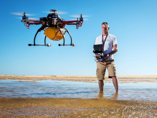 Unmanned aircraft ... Victorian paramedic Robin Lowe has developed a prototype drone that he says could be used to revolutionise surf and rescue operations. The gadget can be launched and deploy flotation devices. Picture: Jake Nowakowski