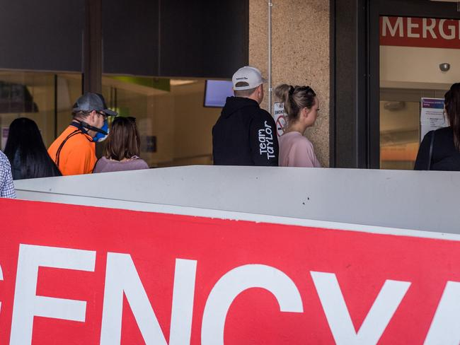 People queue for a fever clinic at Sunshine Hospital, Melbourne. Picture: Jake Nowakowski