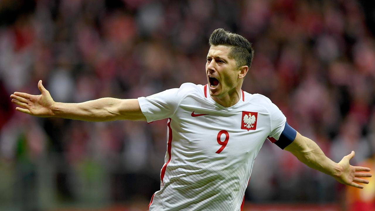Poland's forward Robert Lewandowski reacts after scoring a goal during the FIFA World Cup 2018 qualifiers.
