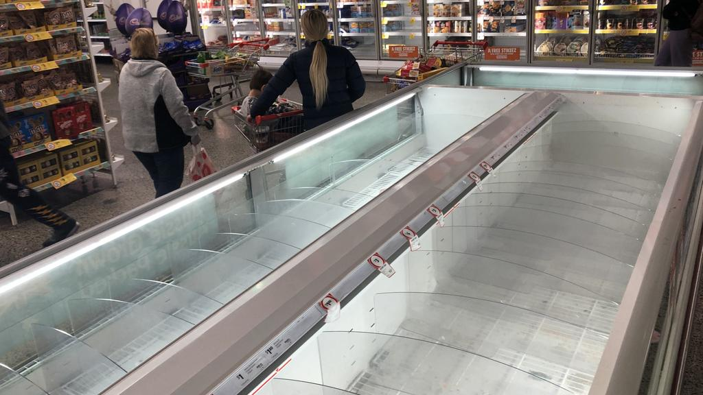 Shoppers at Coburg Coles, Melbourne, emptied shelves and freezers. Picture: David Crosling
