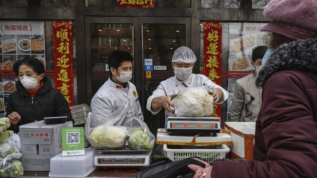 Vendors sell vegetables in the street in Beijing. Picture: Kevin Frayer/Getty Images