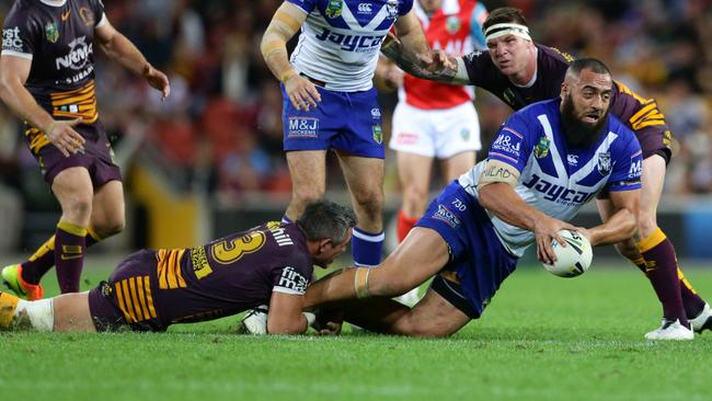 Sam Kasiano of the Bulldogs tackled by Corey Parker.