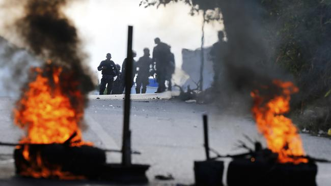 Security forces say they have put down a pre-dawn uprising by national guardsmen that triggered violent street protests.