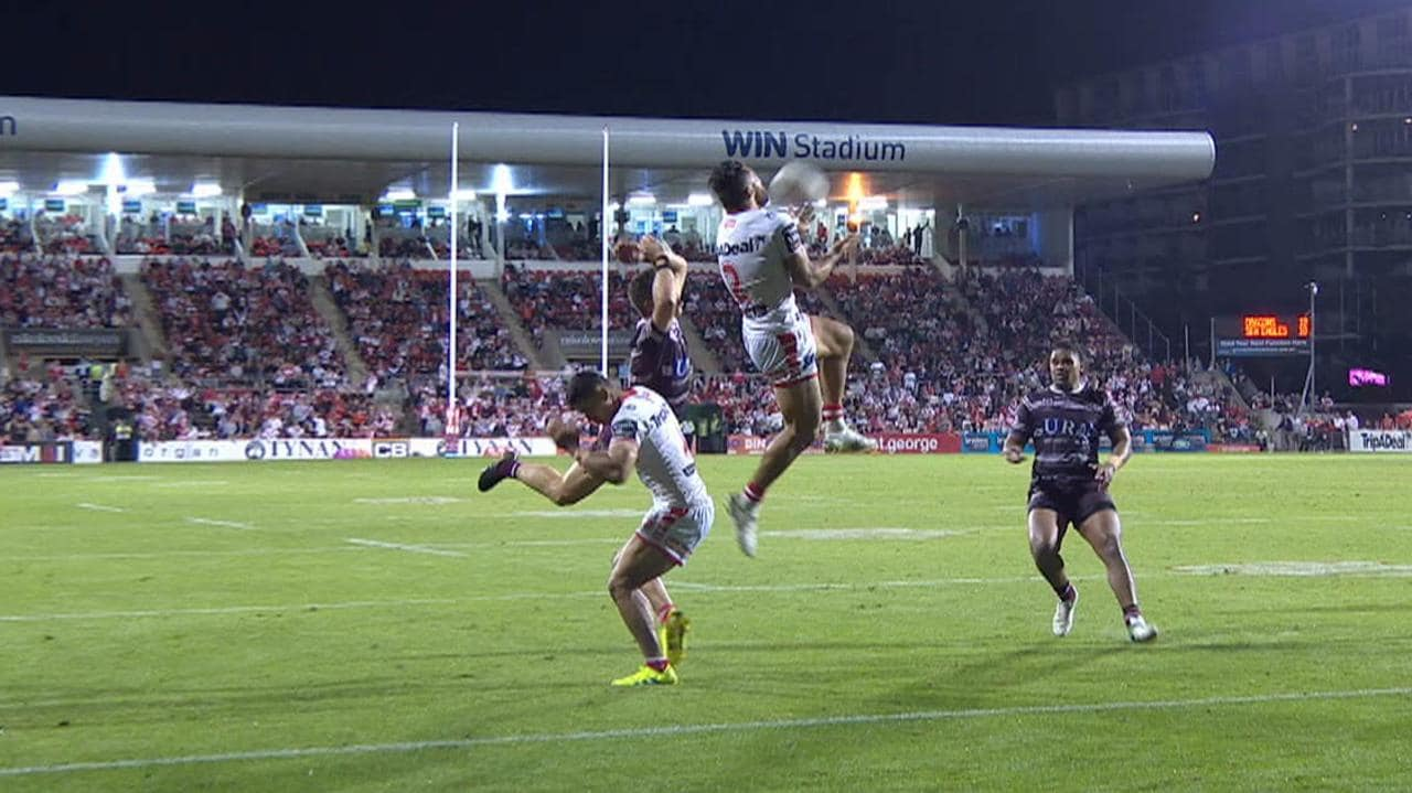 Reuben Garrick collides with Tim Lafai in the final play of the game.