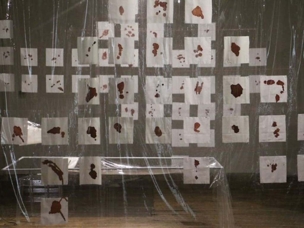 Another of Vulcan's projects is an installation featuring her own blood splatters on cotton.