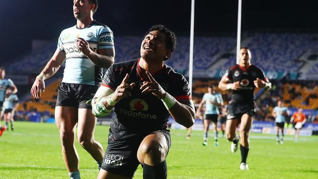 Solomone Kata of the Warriors celebrates after scoring a try.