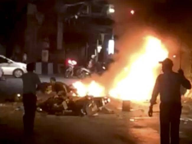 Horrific blast ... flames can be seen after the explosion, during evening rush hour. Picture: Mongkol Nunthalikitkun via AP