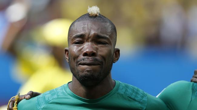 Ivory Coast's midfielder Geoffroy Serey Die cries as he listens to his national anthem.