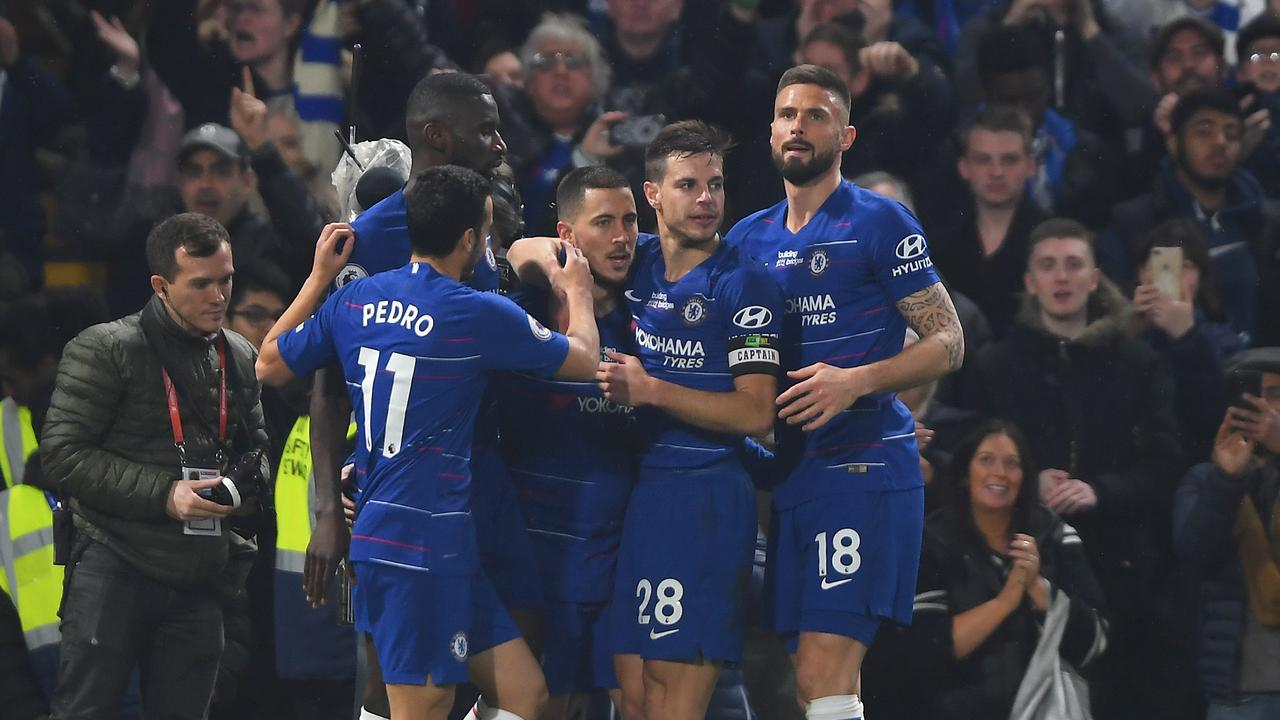 Eden Hazard is mobbed by his Chelsea teammates after scoring his team's second goal
