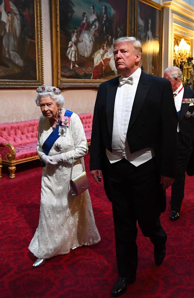 Mr Trump frequently breaks royal protocol by walking in front of the Queen. Picture: Victoria Jones /POOL/AFP