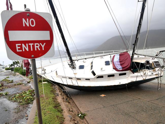 A boat is seen smashed against the bank at Shute Harbour, Airlie Beach after the cyclone hit yesterday. Picture: AAP Image/Dan Peled