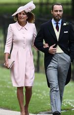 James Middleton (R), brother of the bride, walks with his mother Carole Middleton as they attend the wedding of Pippa Middleton and James Matthews. Picture: AFP PHOTO / POOL / Justin TALLIS