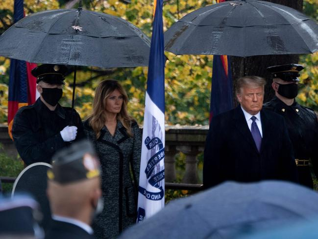 Trump and wife Melania stood separately for the service. Picture: Brendan Smialowski / AFP