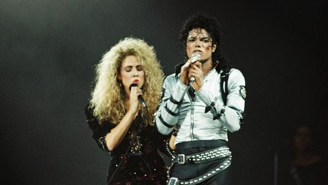 Sheryl Crow sings on stage with Michael Jackson during his Bad tour at Wembley Stadium in July 1988. Picture: Pete Still/Redferns