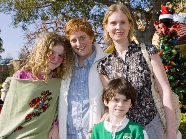 In this image released by Disneyland, actor Cynthia Nixon, right, poses with Samantha (now Samuel) at the age of 12, left, her partner Christine Marinoni and son Charlie, 6. Picture: AP Photo/Disneyland, Paul Hiffmeyer