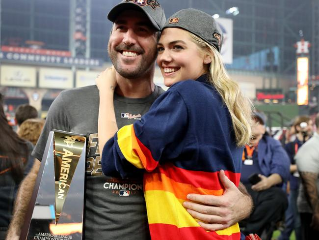 Verlander with supermodel wife Kate Upton and the American League Championship MVP trophy.