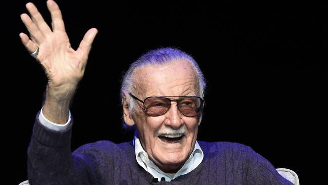 Stan Lee waves to the audience after being introduced on stage at a tribute. Picture: AP