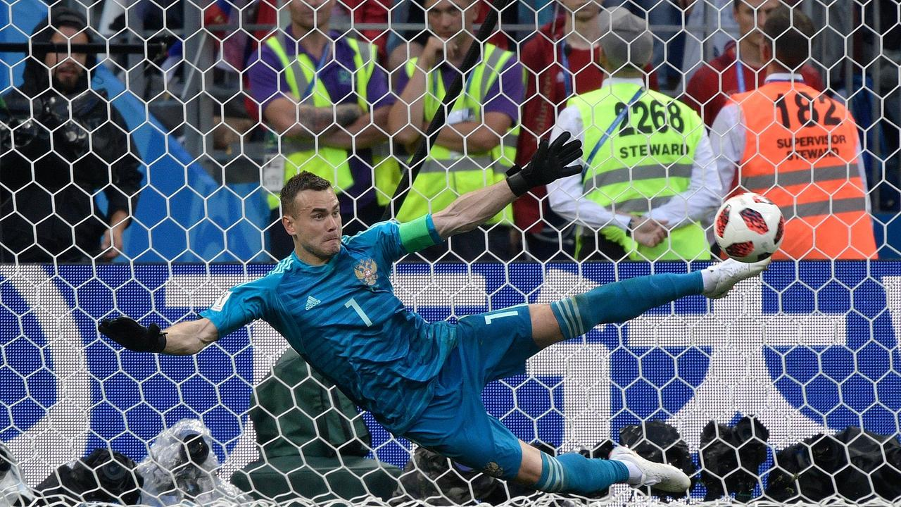 Image result for Russia's goalkeeper Igor Akinfeev saves a penalty with his foot.