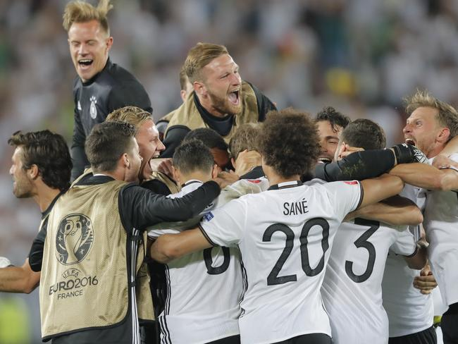 Germany's players celebrate after Jonas Hector scored the winning penalty.